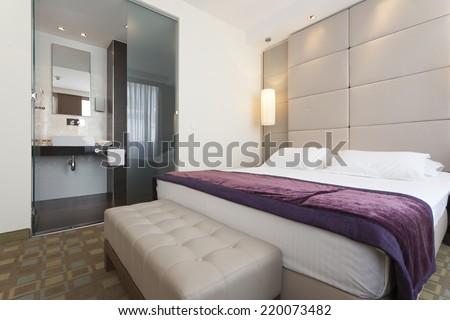 Interior of a luxury hotel bedroom with bathroom  - stock photo