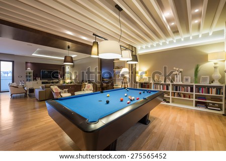 Interior Of A Luxury Living Room With Pool Table Part 38