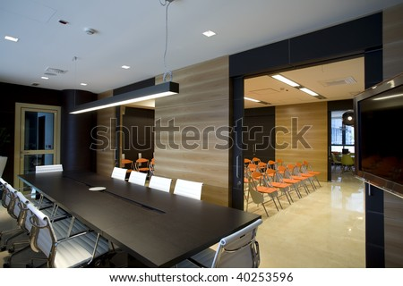 interior of a modern boardroom with view to a conference room