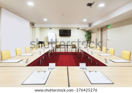 Interior of a modern conference room, tables with built in power supply.  - stock photo