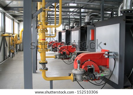 Interior of a modern hi-tech gas boiler-house with industrial coppers