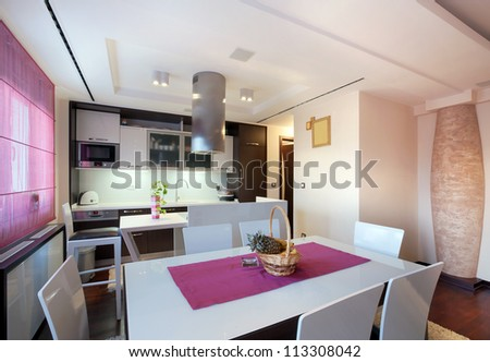 Interior of a modern home, view on dining room and kitchen. - stock photo
