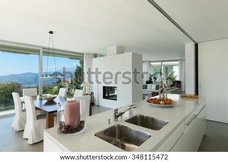 Interior of a modern house, nice dining room and kitchen - stock photo