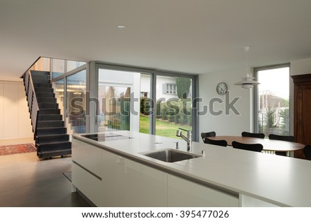 Interior of a modern house, wide open space with kitchen