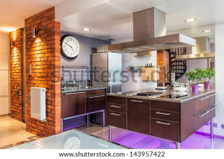 Interior of a modern kitchen and a furniture - stock photo
