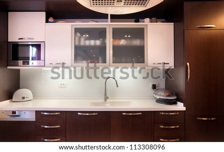 Interior of a modern kitchen, wooden furniture, simple and clean.