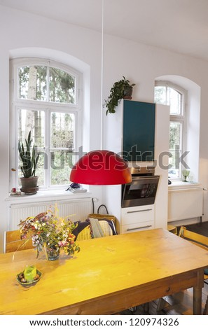 interior of a modern living-dining room in a country style home - stock photo