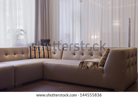 Interior of a modern living room in  luxury mansion - stock photo