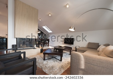 Interior of a modern loft apartment with fireplace - stock photo