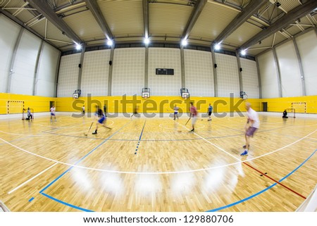 interior of a modern multifunctional gymnasium with young people - stock photo