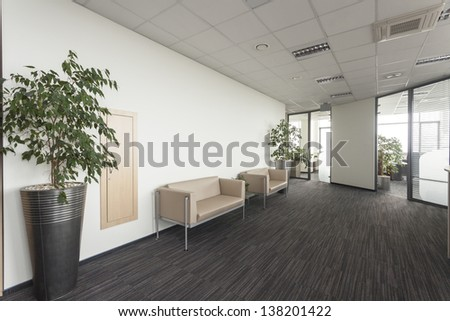 Interior of a modern office, corridor with two sofa - stock photo
