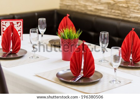 Interior of a modern restaurant, a table set - stock photo