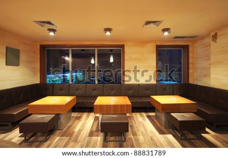 Interior of a modern restaurant, classical design, by night. - stock photo