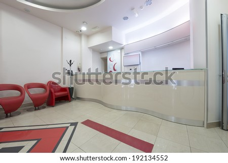 Interior of a modern waiting room with reception desk - reception area  - stock photo