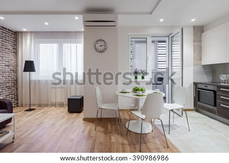 Interior of a new modern apartment in scandinavian style with kitchen and living room - stock photo
