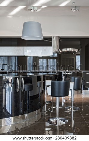 Interior of a new modern luxury kitchen in daylight - stock photo