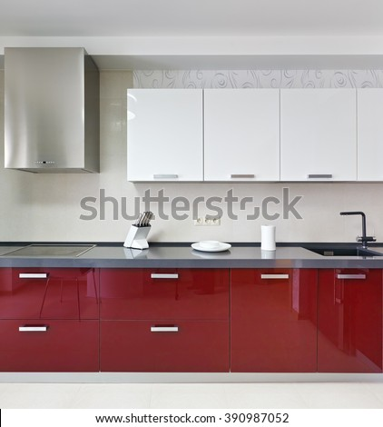 Interior of a new modern red kitchen - stock photo