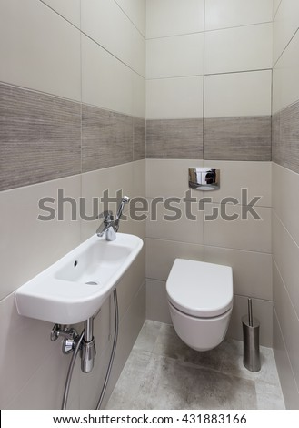 Interior of a new modern restroom - stock photo