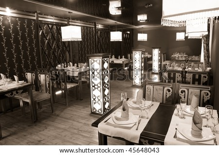 interior of a restaurant in oriental style with square lamps, sepia rendering