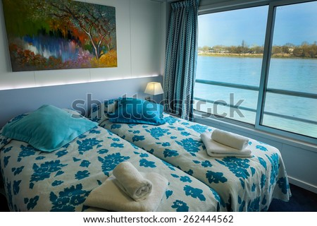 interior of a room or living cabin on a cruise ship with a view of the river Garonne, Bordeaux (France)  - stock photo