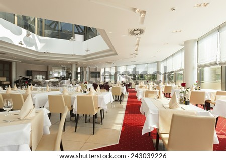 Interior of a spacious empty restaurant - stock photo