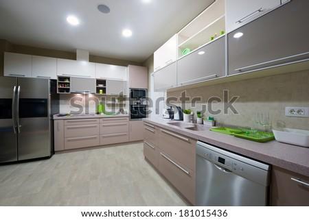 Interior of a spacious modern kitchen - stock photo
