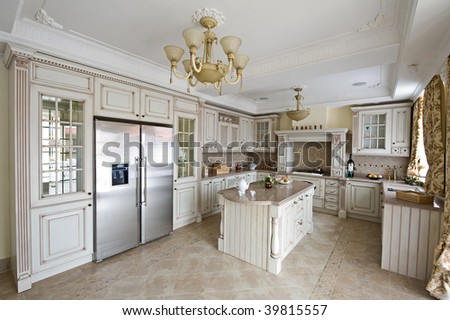 Interior of a table room in in classical style with a kind on kitchen and a bar rack - stock photo