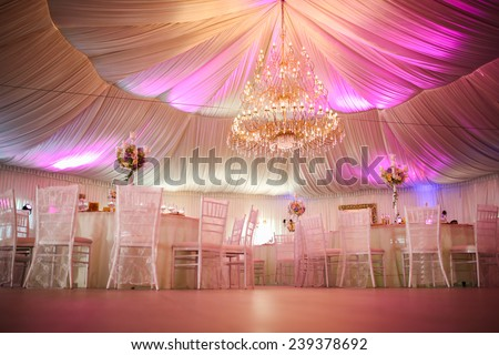 Interior of a wedding tent decoration ready for guests - stock photo
