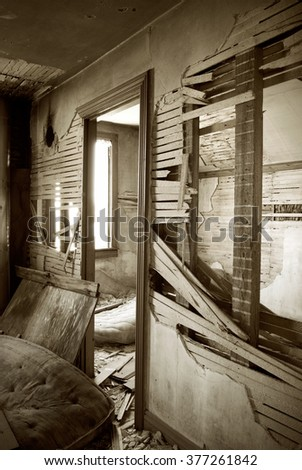 Interior of Abandoned House with Broken Walls Sepia Toned - stock photo