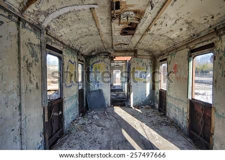 Interior of an abandoned railway wagon - stock photo