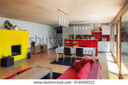 Interior of an eco house, living room and kitchen - stock photo