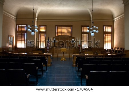interior of an empty old courtroom - stock photo