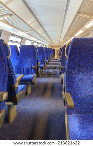 Interior of an empty passenger rail car - stock photo