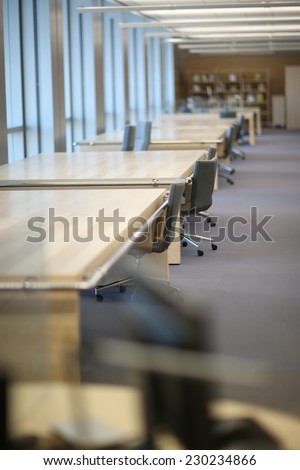 Interior of an empty reading-room at the modern library - stock photo