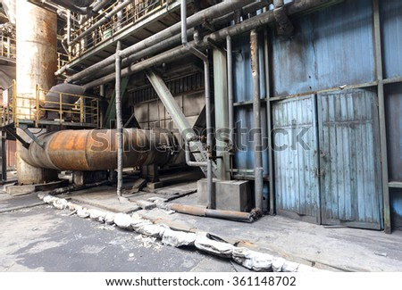 Interior of an old abandoned factory - stock photo