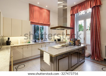 Interior of an old mansion, wide modern kitchen - stock photo