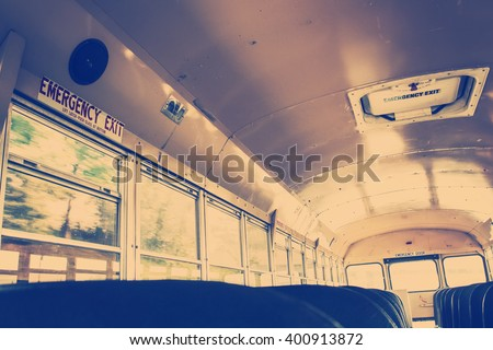 Interior of an old school bus, vintage filter - stock photo