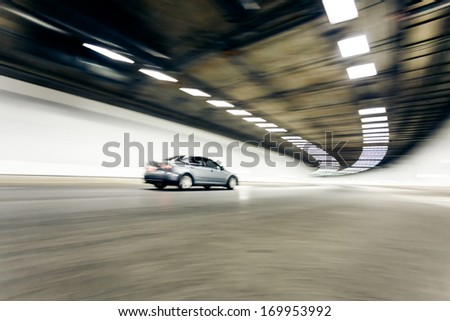 Interior of an urban tunnel with car,motion blur - stock photo