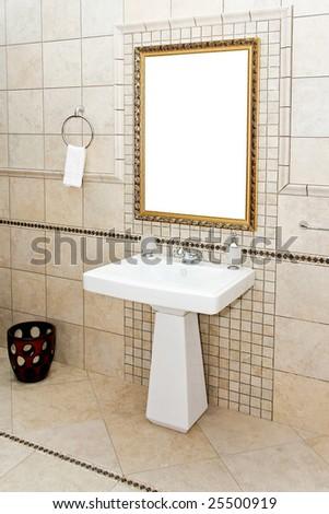 Interior of antique style bathroom with golden mirror - stock photo