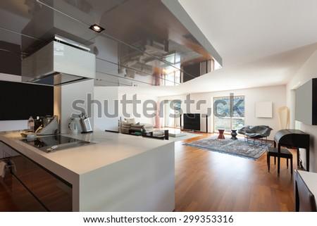 Interior of apartment, wide living room, parquet floor - stock photo