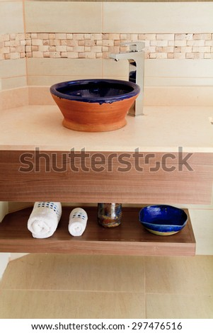 interior of bathroom with towels and some supplies