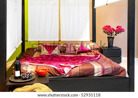 Interior of bedroom with big baldachin bed