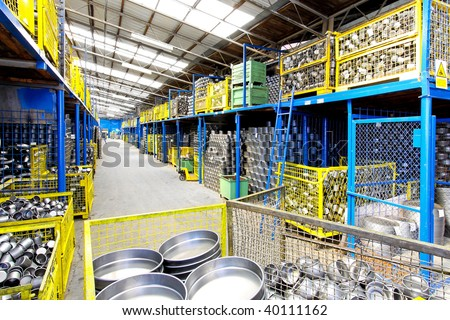 Interior of big warehouse in metal factory