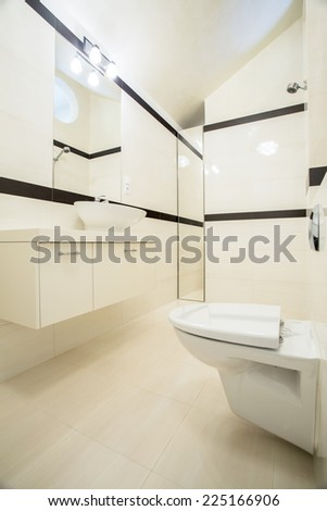 Interior of bright and small bathroom, vertical - stock photo