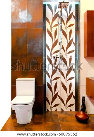 Interior of brown toilet with leaves tiles - stock photo