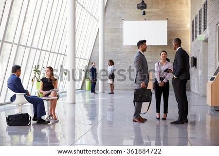 Interior Of Busy Office Foyer Area With Businesspeople - stock photo