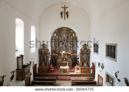 Interior of Capuchin church with nave and altar at Hradcany in Prague.