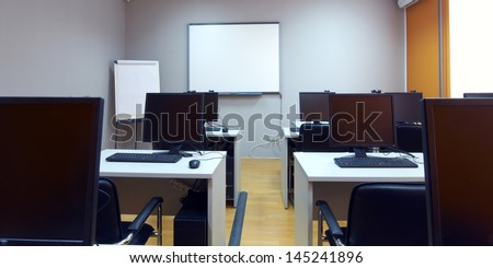 interior of classroom with computers - stock photo