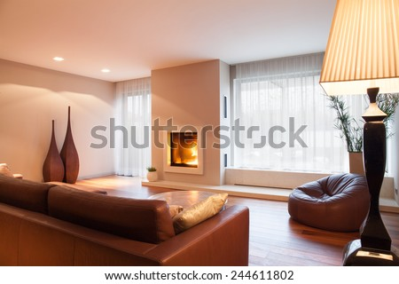 Interior of comfy living room with fireplace - stock photo