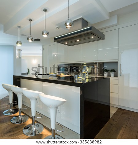 Interior of contemporary kitchen with designer chairs